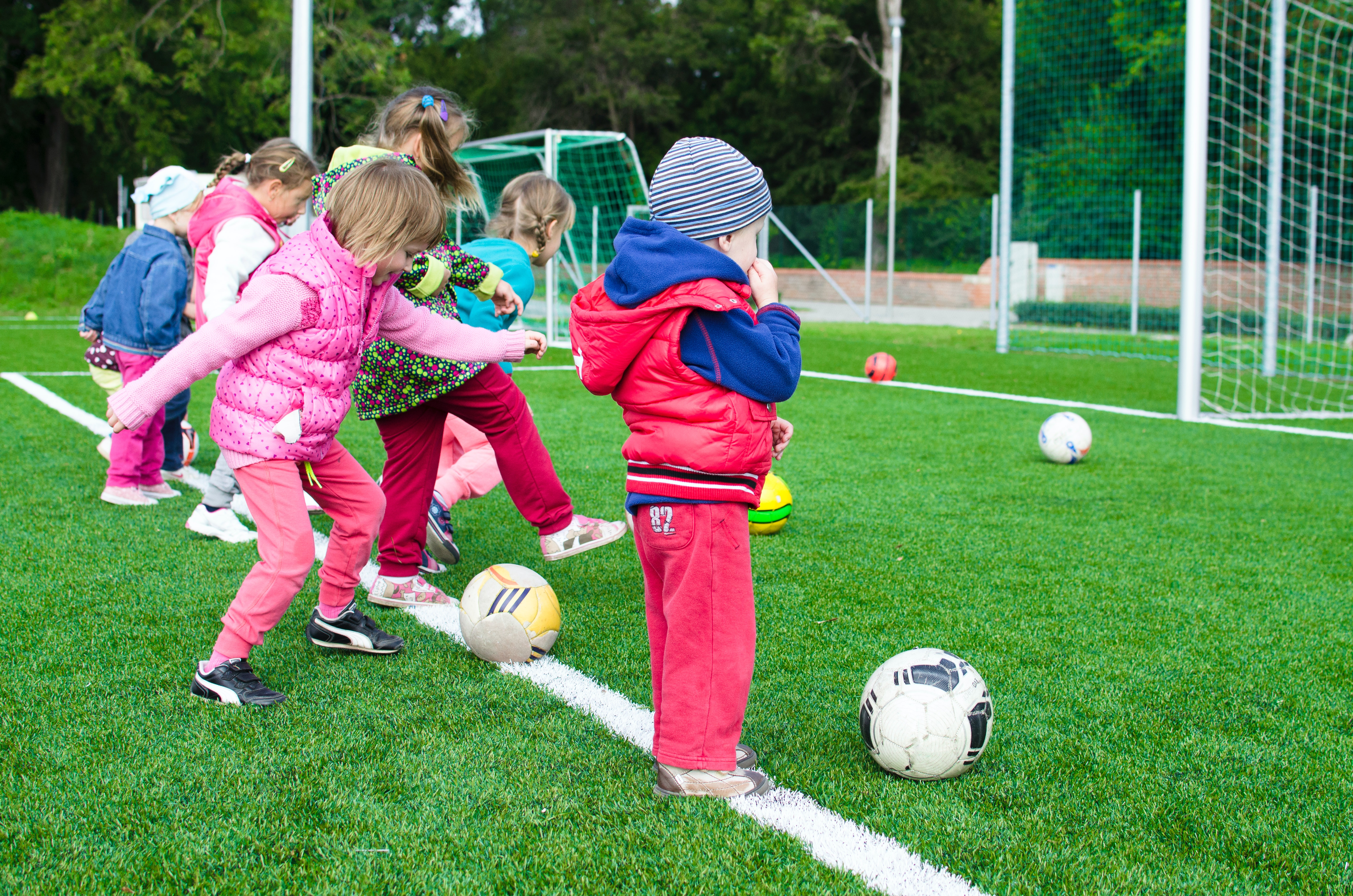 The blog post is about early specialization in sport, there it's appropriate to include a picture of kids kicking soccer balls